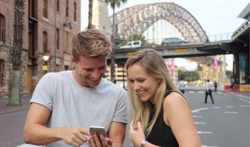 Couple enjoying a scavenger hunt in Melbourne